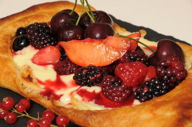 Fruit tart with berries and cream