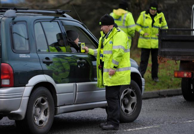 Police breathalyzing drivers. Picture: Colin Horne