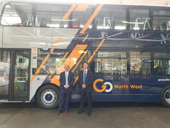 David Brown and David Cutts are pictured in front of a refurbished Volvo B5 Gemini 2 double-deck hybrid bus, retrofitted to Euro 6 standard.