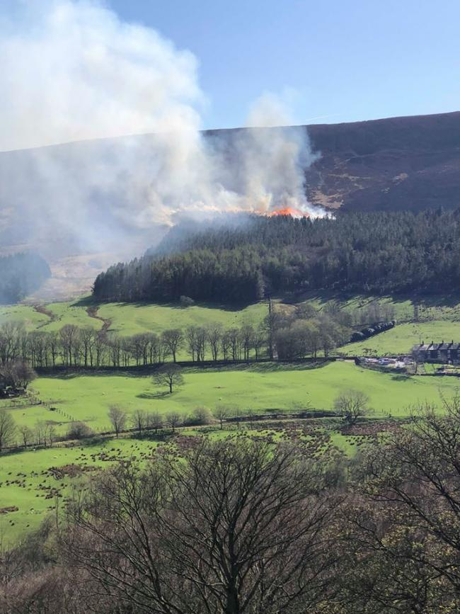 SMOKE: Flames could be seen rising above the hills near to Dovestone Reservoir
