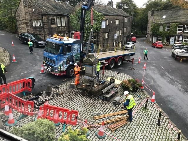 The Dobcross monument gets restored to its rightful place. Picture by David Morris