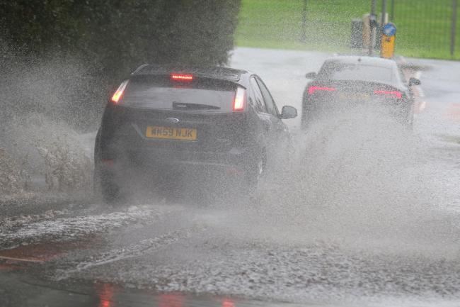 Drivers take on flooded roads after heavy rain in Bolton on October 25. Photo: Phil Taylor