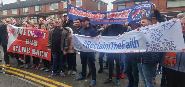 Oldham fans protest ahead of Saturday's game against Leyton Orient. Picture: Chris Stringer