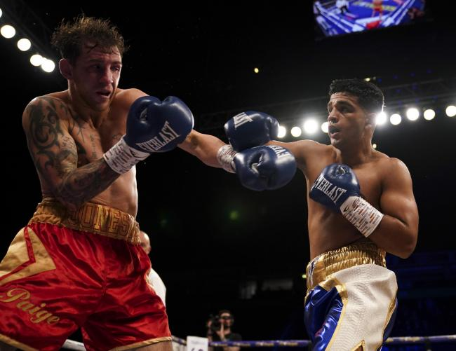 Aqib Fiaz on his way to victory over Sean Jones