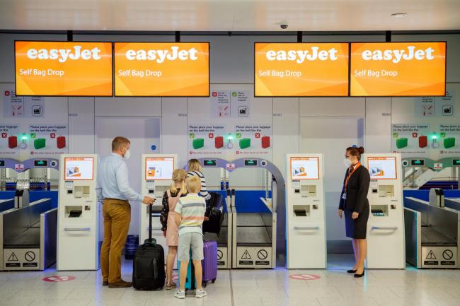 Undated handout photo issued by EasyJet of new bio security measures taking place at an EasyJet checkout counter, as the low-cost carrier is to resume flights from a number of UK airports from June 15. PA Photo. Issue date: Thursday May 21, 2020. As part