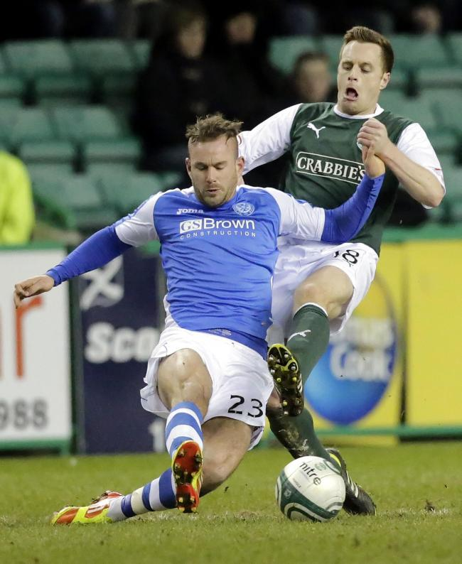 St Johnstone's Rowan Vine and Hibernian's Alan Maybury fight for the ball during the Clydesdale Bank Scottish Premier League match at Easter Road, Edinburgh. PRESS ASSOCIATION Photo. Picture date: Monday February 11, 2013. See PA story SOCCER Hibe
