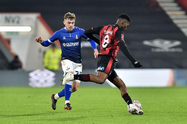 Oldham Athletic's Alfie McCalmont closes down Jefferson Lerma of Bournemouth.