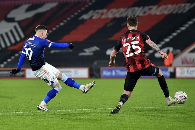 ATTACK: Zak Dearnley goes for goal at Bournemouth in the FA Cup