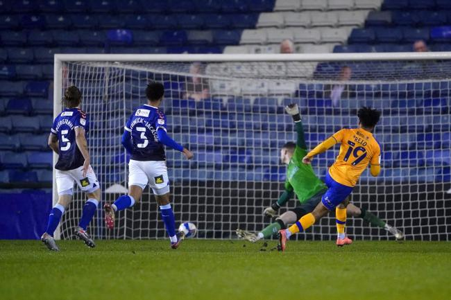 Mansfield's Jamie Reid scores his side's third goal at Boundary Park