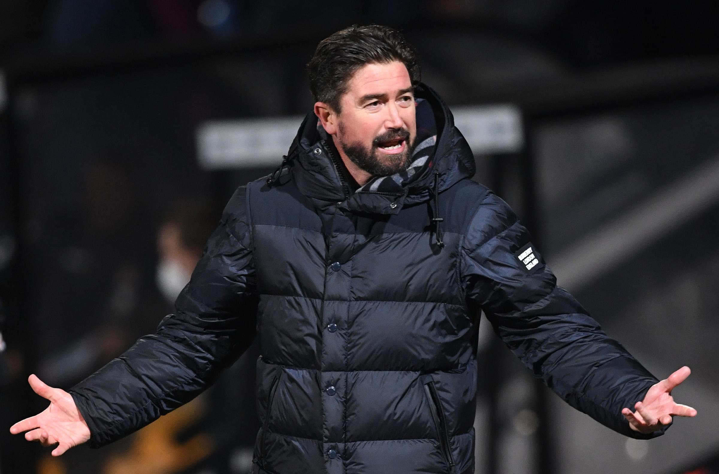 Oldham Athletic manager Harry Kewell gestures on the touchline during the Sky Bet League Two match at the Abbey Stadium, Cambridge..