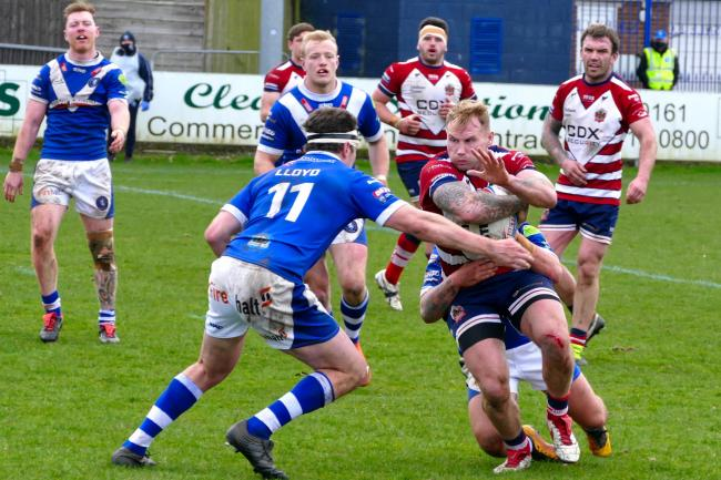 ON THE ATTACK: Danny Langtree sees his charge halted. Pictures: Dave Naylor