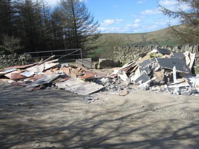 NIGHTMARE: Rubble dumped at the Saddleworth Hotel