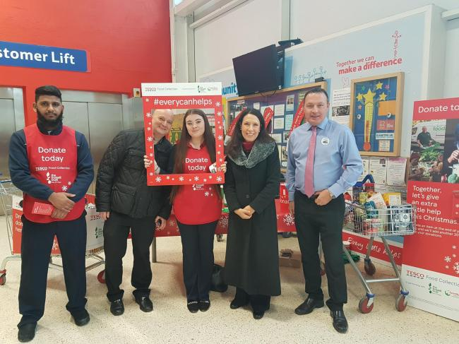 APPEAL: Tesco general assistant Abdul Hamid, left, with Oldham Foodbank manager Andrew Barr, Tesco community champion Emma Ferguson, Debbie Abrahams MP and store manager Andrew Brown