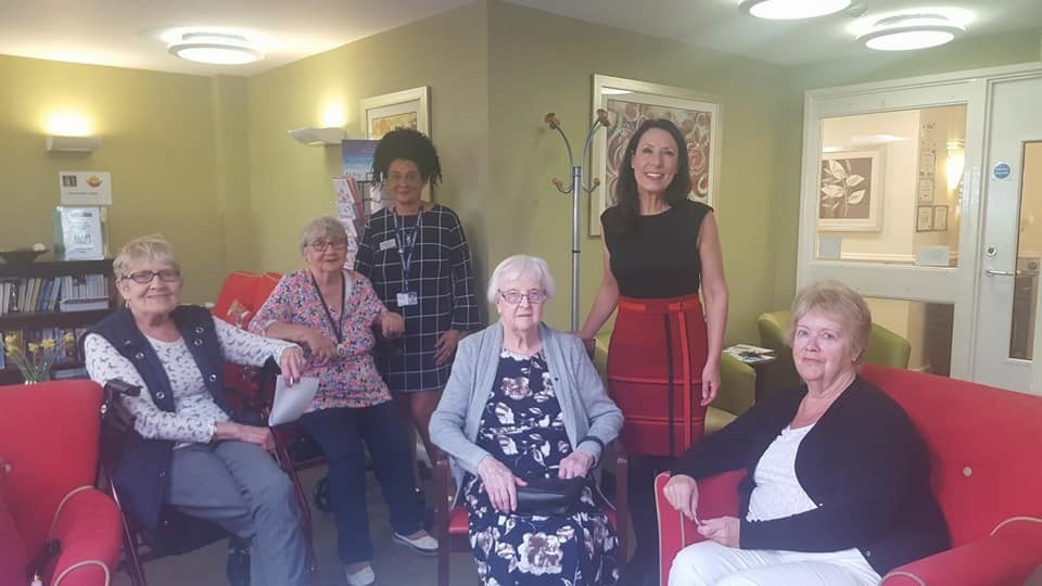 MP Debbie Abrahams, second from right, with staff and residents at Springlees