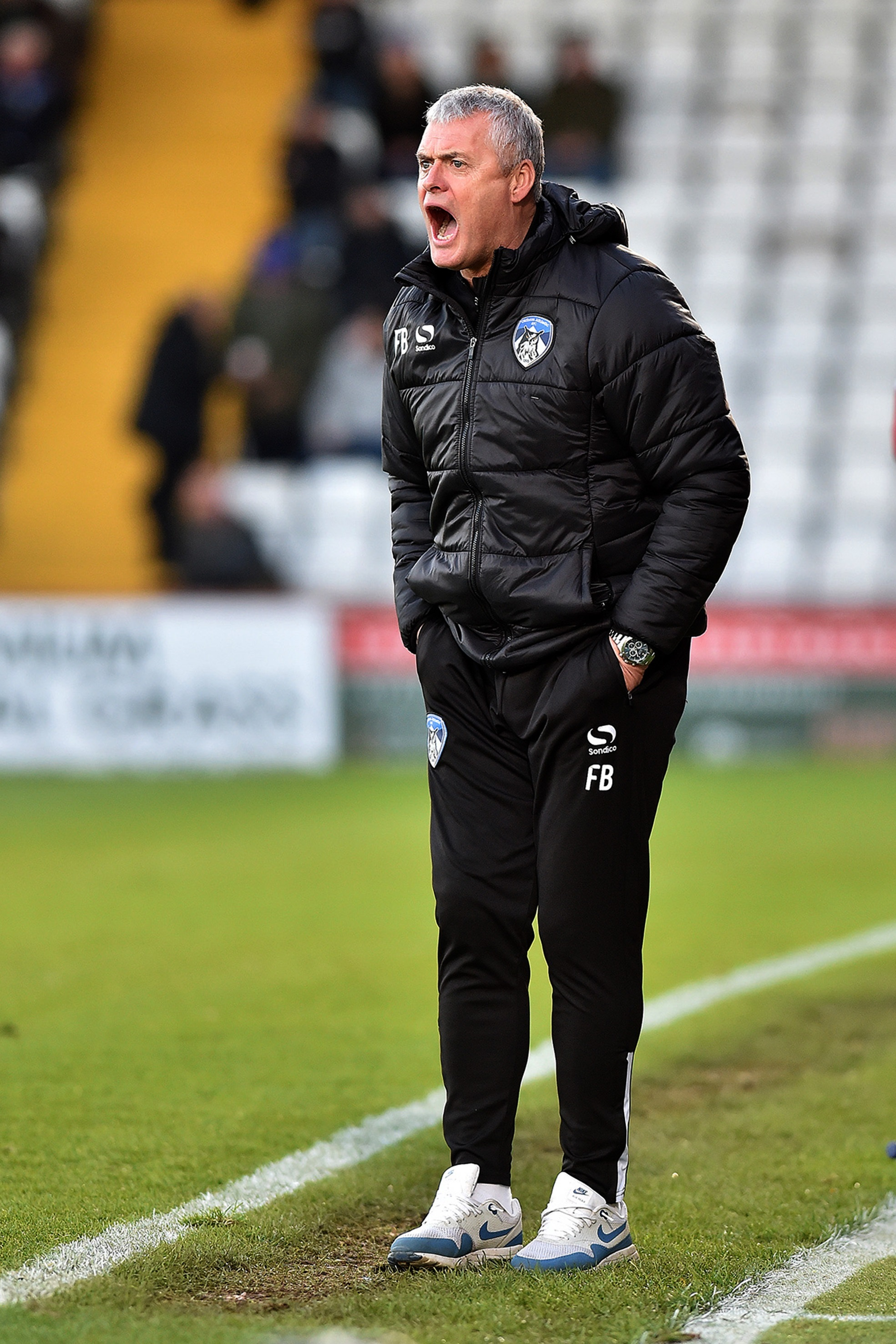 Latics boss Frankie Bunn shouts from the touchline at Stevenage