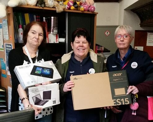 From left Oldham Foodbank manager Lisa Leunig receives donations from Rose Knipe and Wendy Lindsay who work for Tesco in Failsworth