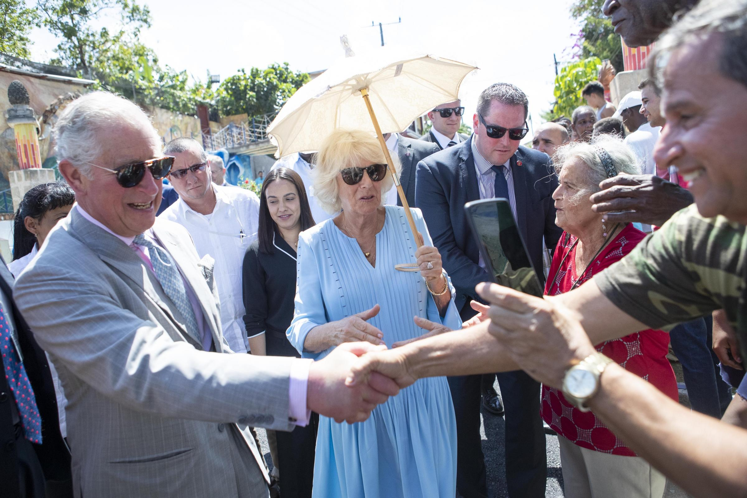 The Prince of Wales and the Duchess of Cornwall meet members of the public in Havana