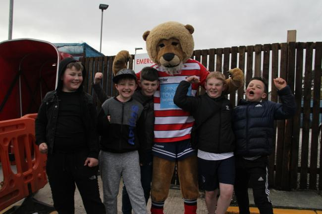 Roary and some young Roughyeds fans. Oldham were well backed against London and they hope to have the same again when they face Widnes. Picture by dave Naylor