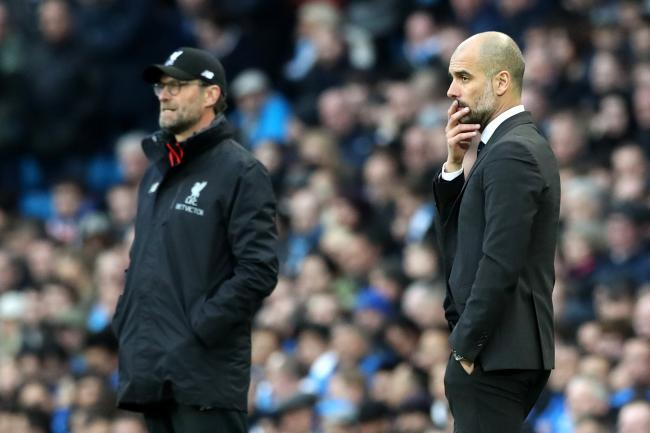 Jurgen Klopp, left, and Pep Guardiola are going head-to-head for the title