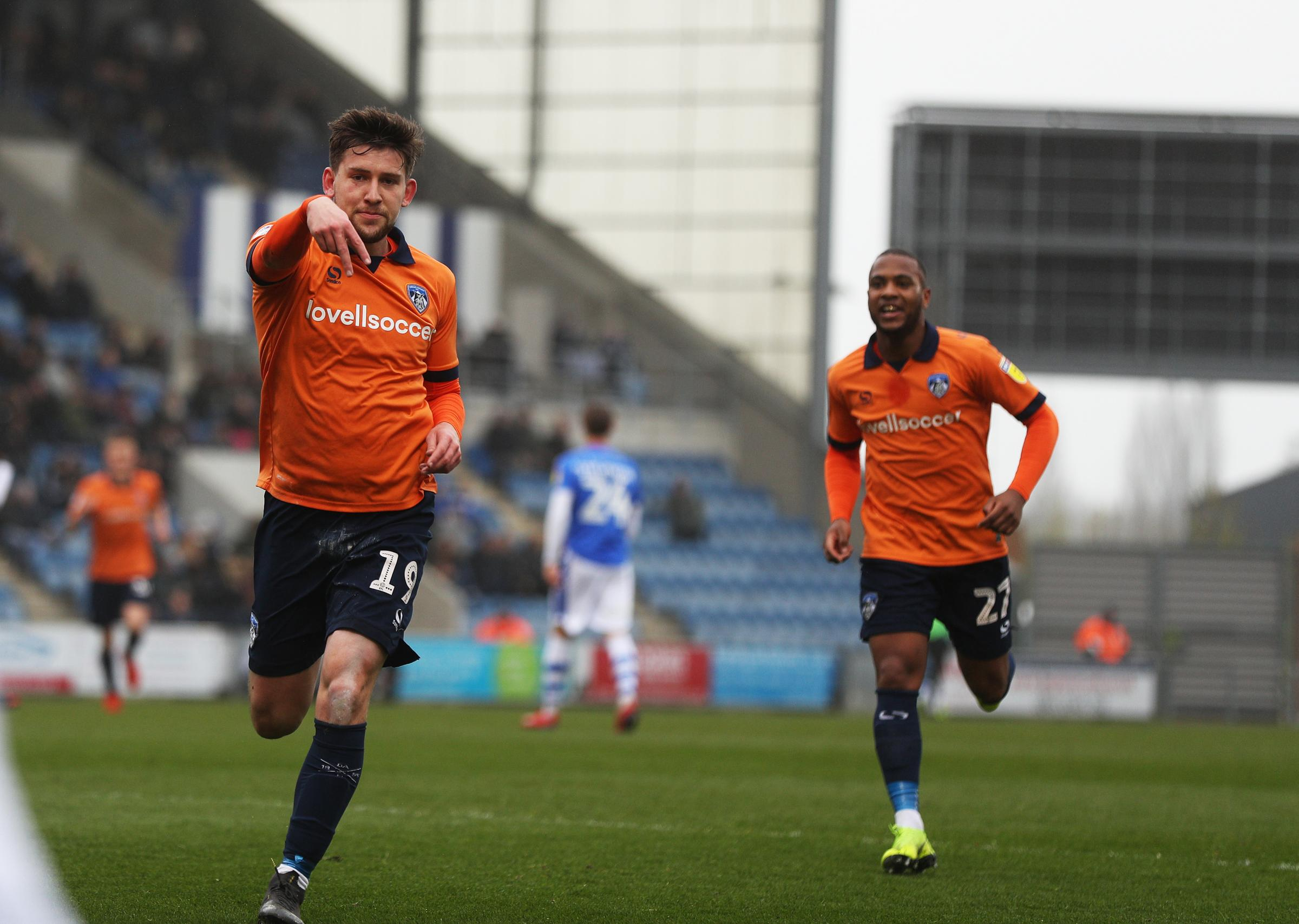 CELEBRATION: Oldham's Callum Lang scored at Colchester