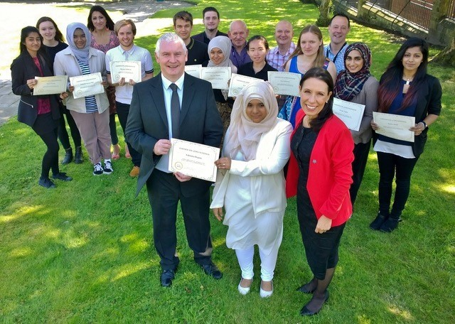 Tahmina, along with the other participants of a previous summer school, being awarded their 'graduation' certificates by special guest Bryn Hughes, father of the late PC Nicola Hughes, and Debbie