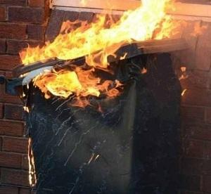 A file picture of a burning wheelie bin