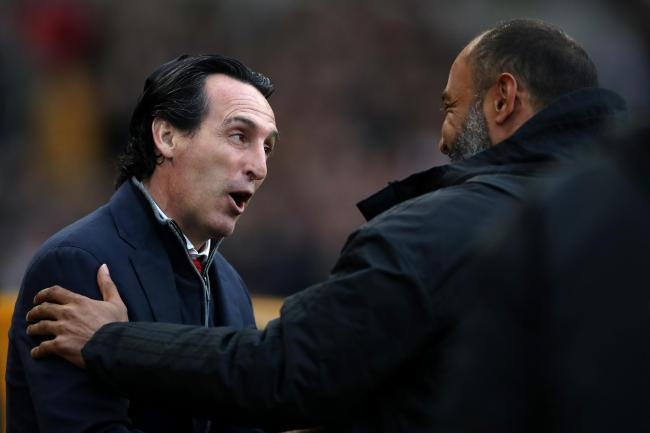 Unai Emery and Nuno Espirito Santo embrace at Molineux